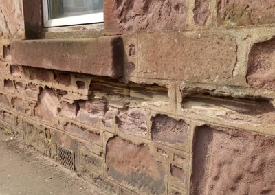 Cement pointing damaged stone